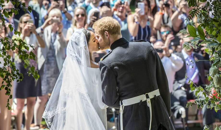 Meghan Markle and Prince Harry kiss on the steps of St George's Chapel after  their wedding ceremony in Windsor Castle in Windsor, near London, England, Saturday, May 19, 2018. (Danny Lawson/pool photo via AP) Photo: Danny Lawson, Associated Press