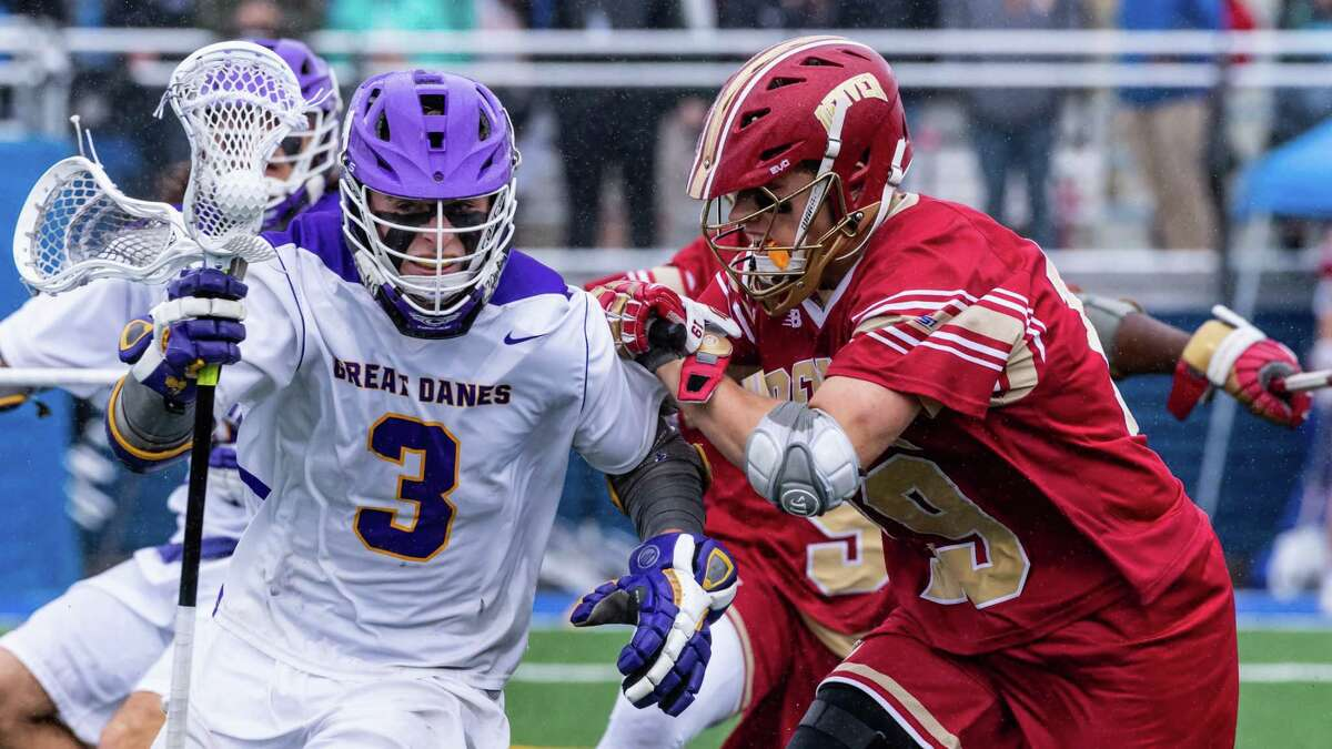 UAlbany's TD Ierlan takes possession of a faceoff as he eludes a Denver defender. The Great Danes defeated the Pioneers 15-13 to advance to next weekend's Final Four in Foxborough, Mass. (Bill Ziskin / UAlbany Athletics)