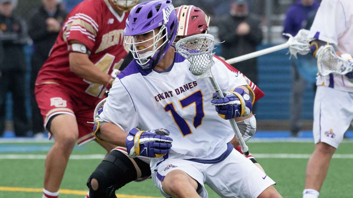 UAlbany's Jakob Patterson powers his way toward the Denver goal. The Great Danes defeated the Pioneers 15-13 on Saturday, May 19, 2018, to advance to next weekend's Final Four in Foxborough, Mass. (Bill Ziskin / UAlbany Athletics)