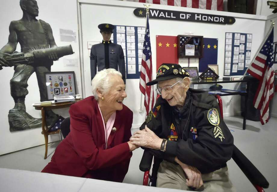 West Haven, Connecticut - Saturday,  May 19, 2018: World War II veteran Robert Swirsky of Orange, 98, and Hedwige Kuepper of Milford, 87, who, as a teenager, saw Swirsky and his U.S. Army unit pass through her town of Seaus, outside of Paris, during the liberation of France during World War II, have a quiet moment at the West Haven Veterans Museum and Learning Center honoring Swirsky Saturday while sharing their personal stories of the liberation with guests at the museum. Kuepper's life has been shaped by that moment of history and she shared her appreciation to Swirsky. Photo: Peter Hvizdak / Hearst Connecticut Media / New Haven Register