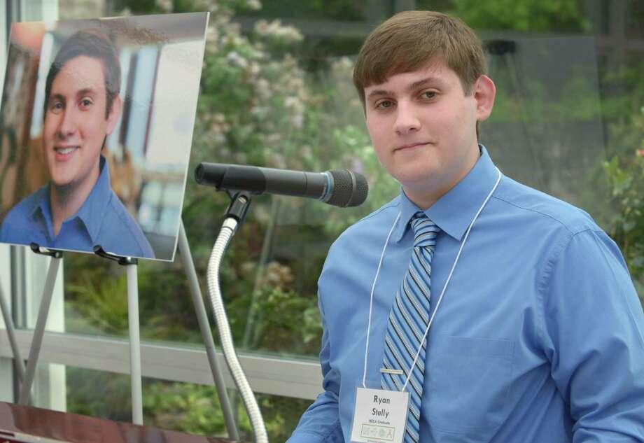 Norwalk High School senior Ryan Stelly speaks at a ceremony for first Norwalk Earlly College Academy NECA gradautes Thursday, May 17, 2018, at the Norwalk Inn in Norwalk, Conn. Photo: Erik Trautmann / Hearst Connecticut Media / Norwalk Hour