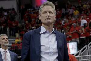 Coach Steve Kerr enters the court as the Golden State Warriors play the Houston Rockets in Game 2 of the Western Conference Finals at Toyota Center in Houston, Texas, on Wednesday, May 16, 2018.