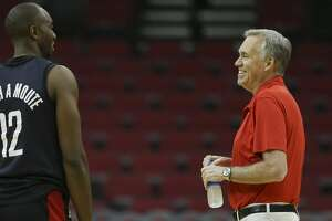 Houston Rockets' Luc Mbah a Moute and head coach Mike D'Antoni talke during practice at Toyota Center before they take off to Oakland on Friday, May 18, 2018, in Houston. ( Yi-Chin Lee / Houston Chronicle )