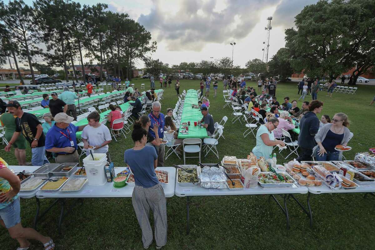 Members of the community held a potluck dinner for the victims of the Santa Fe High School shooting Saturday, May 19, 2018, in Santa Fe.