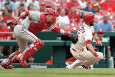 The Cardinals' Matt Carpenter, right, is tagged out by Phillies catcher Andrew Knapp in the seventh inning of Saturday,'s game in St. Louis.