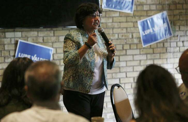 Democratic gubernatorial candidate Lupe Valdez (center) stumps for her campaign at Blue Star Brewing on Saturday, May 19, 2018. The Democrats' debate over how best to capitalize on the anger and angst stirred by Trump is exemplified -- albeit imperfectly -- by the candidates competing for the party nod for governor, former Dallas County sheriff Lupe Valdez and Houston businessman Andrew White. On Saturday, Valdez and Castro spoke in San Antonio to a roomful of voters about their choices between a moderate who can appeal to Republicans and a progressive candidate who was expected to excite the base. (Kin Man Hui/San Antonio Express-News)