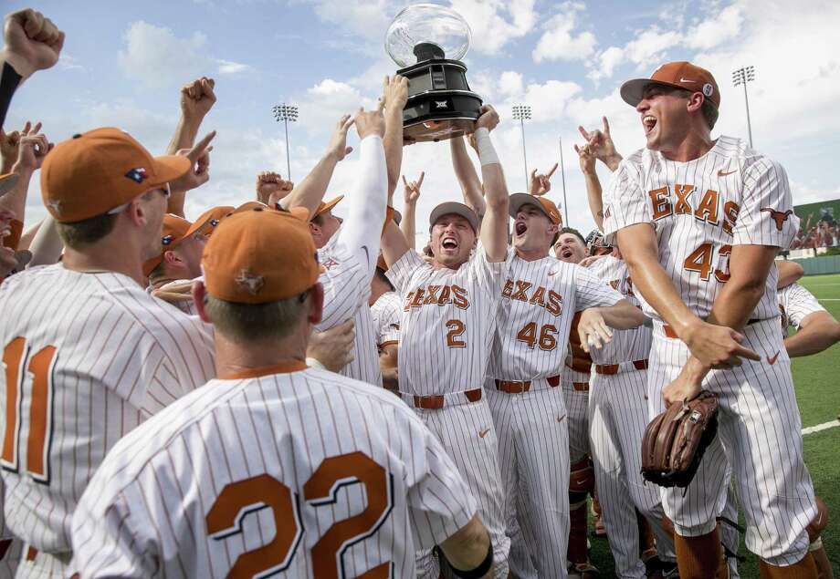 Texas' Kody Clemens (2) and Brandon Ivey (46) hoist the Big 12 regular-season championship trophy. Photo: Jay Janner / Associated Press / Austin American-Statesman