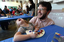 Penelope Neyland cracks up her father Cory Neyland as she makes a critter mask during the May Family Arts Day at the Art Museum of Southeast Texas. Families enjoyed crafts including mask and crown-making, critter cookies, face painting and a musical interactive performance. AMSET offers the family-friendly arts days monthly. Photo taken Saturday, May 19, 2018 Kim Brent/The Enterprise