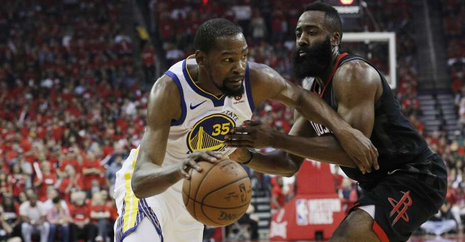 Kevin Durant (35) drives to the basket around James Harden (13) as the Golden State Warriors played by the Houston Rockets in Game 2 of the Western Conference Finals at Toyota Center in Houston, Texas, on Wednesday, May 16, 2018. The Rockets won 127-105. Photo: Carlos Avila Gonzalez/The Chronicle
