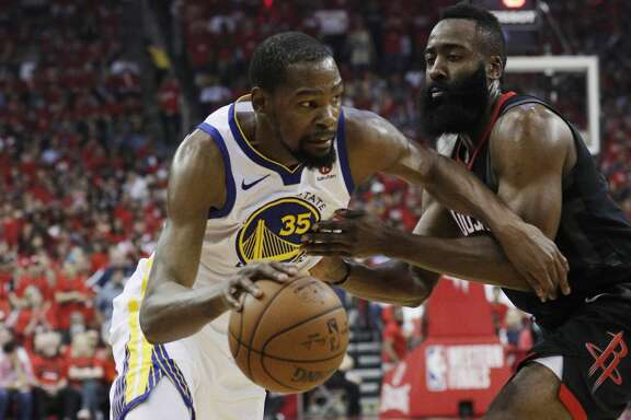 Kevin Durant (35) drives to the basket around James Harden (13) as the Golden State Warriors played by the Houston Rockets in Game 2 of the Western Conference Finals at Toyota Center in Houston, Texas, on Wednesday, May 16, 2018. The Rockets won 127-105.