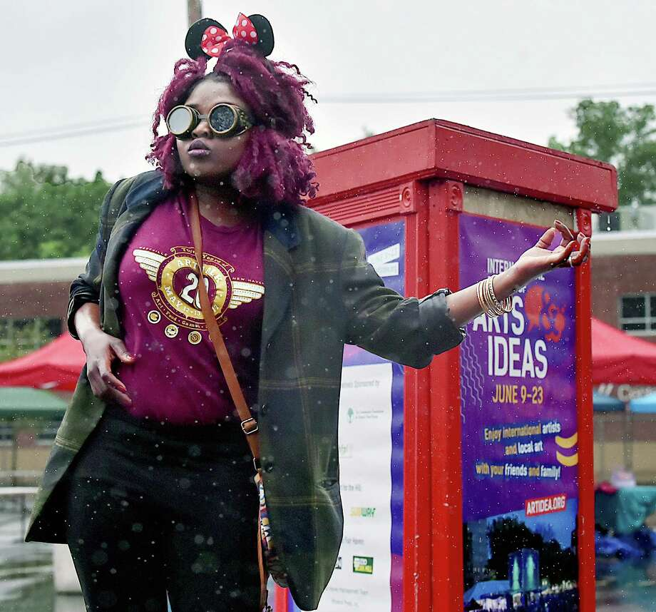 Westville songstress Thabisha Rich dances and plays the air guitar in the rain to the music of Manny James and the Soulclectics, Saturday, May 19, 2018, at Hillfest at Cornell Scott Hill Health Center in the Hill section of New Haven. Hillfest, a one-day neighborhood festival is a collaborative effort between the International Festival of Arts & Ideas, Cornell Scott Hill Health Center and New Haven Bike Month. Photo: Catherine Avalone, Hearst Connecticut Media / New Haven Register