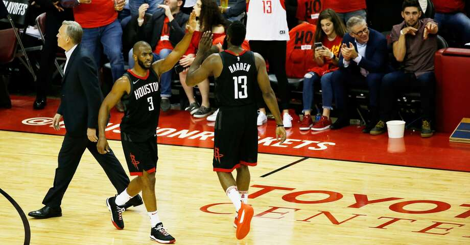 HOUSTON, TX - MAY 16:  Chris Paul #3 and James Harden #13 of the Houston Rockets react in the second half against the Golden State Warriors in Game Two of the Western Conference Finals of the 2018 NBA Playoffs at Toyota Center on May 16, 2018 in Houston, Texas.  (Photo by Tim Warner/Getty Images) Photo: Tim Warner/Getty Images