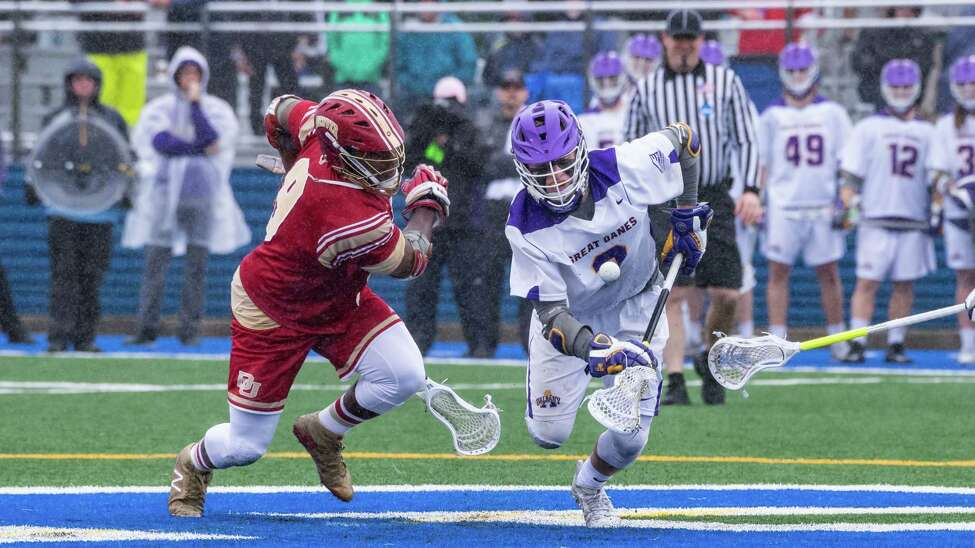 UAlbany's TD Ierlan outduels Denver's Trevor Baptiste in their much-anticipated matchup of faceoff specialists. The Great Danes defeated the Pioneers 15-13 Saturday, May 19, 2018, to advance to next weekend's Final Four in Foxborough, Mass. (Bill Ziskin / UAlbany Athletics)