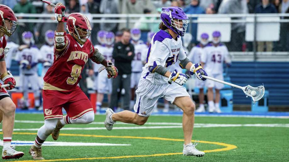 UAlbany's Kyle McClancy sprints past Denver's Trevor Baptiste on his way to a goal. The Great Danes defeated the Pioneers 15-13 on Saturday, May 19, 2018, to advance to next weekend's Final Four in Foxborough, Mass. (Bill Ziskin / UAlbany Athletics) Photo: BILL ZISKIN / BILL ZISKIN       ALL RIGHTS RESERVED