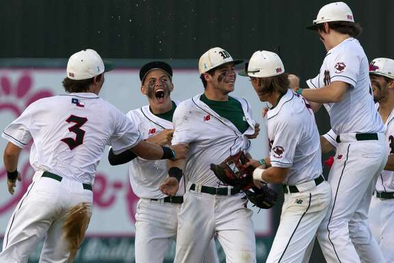 The Woodlands players react after defeating Montgomery 9-2 in Game 3 of a Class 6A Region II quarterfinal series on Saturday, May 19, 2018, in The Woodlands.