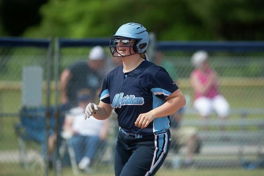 Meridian's Peyton Grice rounds the bases after hitting a home run against Clare in a Division 3 district tournament game last spring. (Daily News file photo) / Midland Daily News