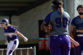 Dayton senior pitcher Brooke Austin, right, shows her disappointment as Elgin's Kiana Gibson, left, runs and jumps around the bases after homering off Austin in the bottom of the 5th inning of game 2 of their Class 5A Region III semi-final matchup at Magnolia West High School on May 19, 2018. (Jerry Baker/For the Chronicle)