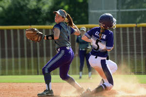 Dayton senior 2nd baseman Bailey Stoker makes a play against Elgin baserunner Eryn Carter in the bottom of the 2nd inning of game 2 of their Class 5A Region III semi-final matchup at Magnolia West High School on May 19, 2018.
