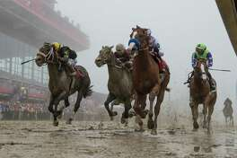Justify with jockey Mike Smith wins the 143rd running of the Preakness Stakes at the Pimlico Race Course on Preakness Day Saturday May 19, 2018 in Baltimore, MD. (Skip Dickstein/Times Union)