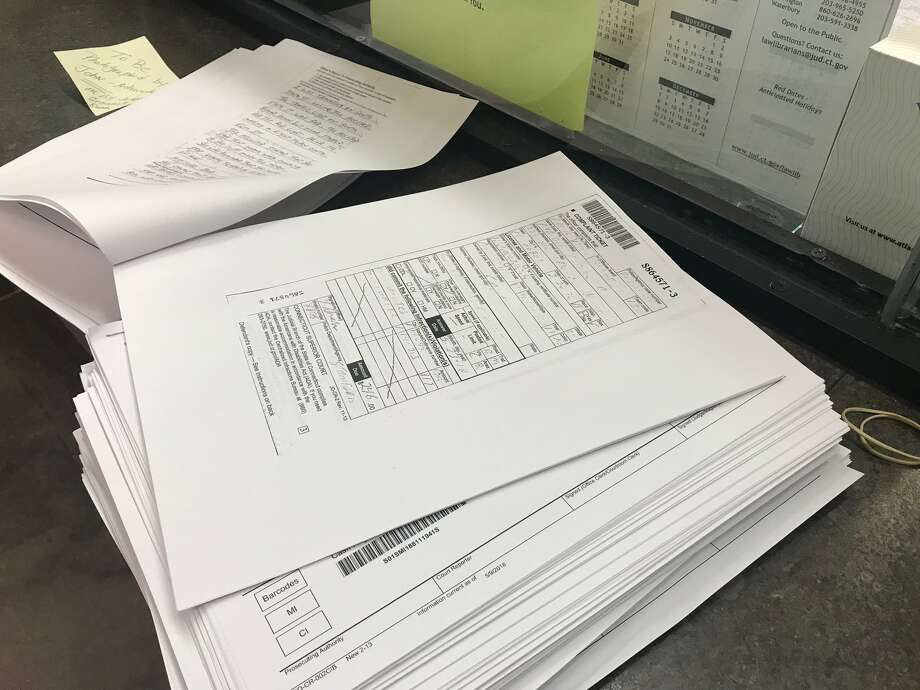 A stack of infraction ticket files being processed at the Stamford courthouse. Photo: John Nickerson / Hearst Connecticut Media