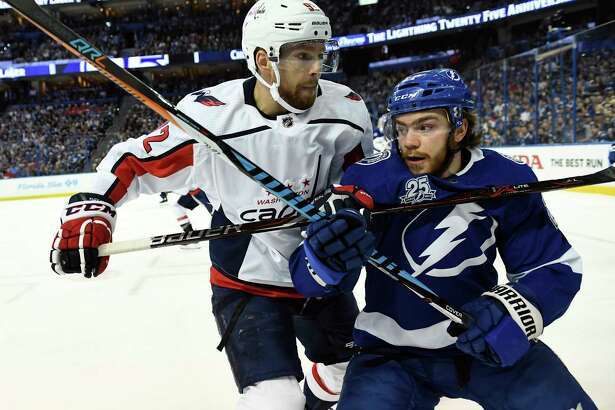 Capitals center Evgeny Kuznetsov (92) checks Lightning center Brayden Point into the boards during the first period of Game 5 of the Eastern Conference Finals between Washington and Tampa Bay on Saturday. Must credit: Washington Post photo by Toni L. Sandys
