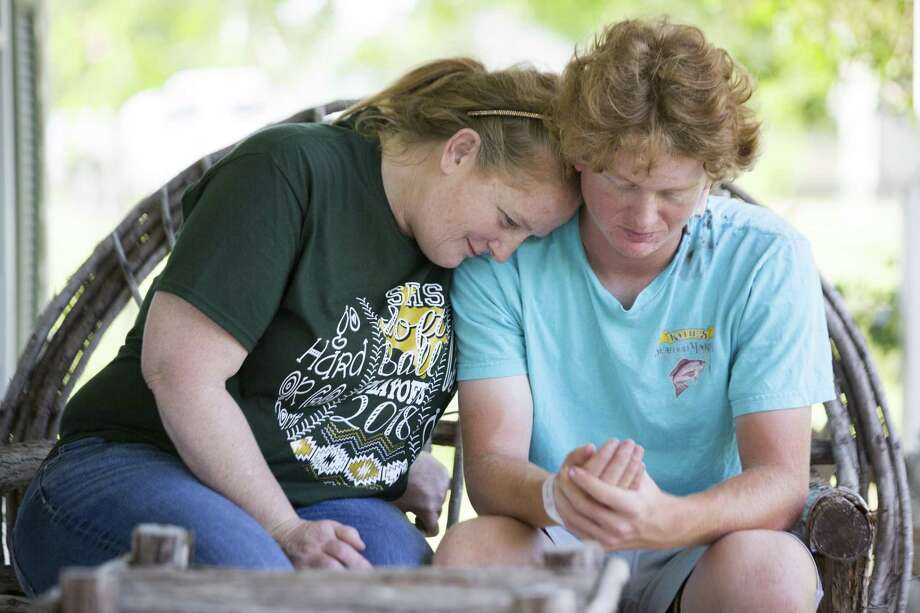 Sheri Shubert shares a moment with her son Rome Shubert, 16, who was shot on the back of the neck during the shooting that took place at his school Santa Fe High School, Friday, May 18, 2018, in Santa Fe. The injury had an entry wound and an exit wound. ( Marie D. De Jesus / Houston Chronicle ) Photo: Marie D. De Jesus, Houston Chronicle / Houston Chronicle / © 2018 Houston Chronicle