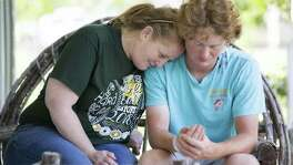 Sheri Shubertshares a moment with her son Rome Shubert, 16, who was shot on the back of the neck during the shooting that took place at his school Santa Fe High School, Friday, May 18, 2018, in Santa Fe. The injury had an entry wound and an exit wound. ( Marie D. De Jesus / Houston Chronicle )