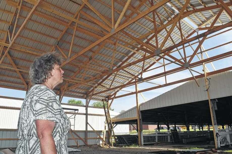 "Caroline Bartz of rural Murrayville, who serves as the Morgan County Fair and 4-H poultry superintendent, looks over the new poultry barn, which will soon be completed on the south side of the Morgan County Fairgrounds. ""I'm very excited to get the new building,"" Bartz said."