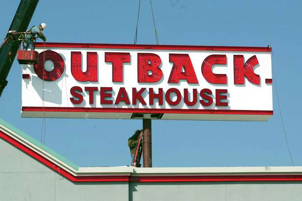 File photo of an Outback Steakhouse sign