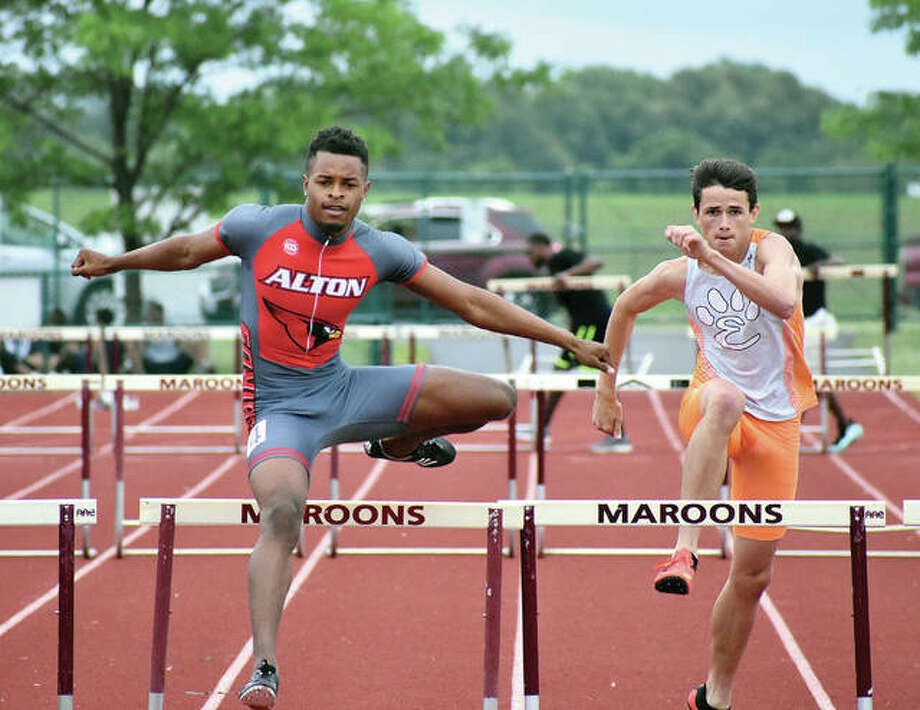 Alton's Jonathon Bumpers, left, edges out Edwardsville's Dan Powell for a second-place finish in the 300-meter hurdles at the Class 3A Belleville West Sectional on Saturday in Belleville. Bumpers qualified for the state meet. Photo: 