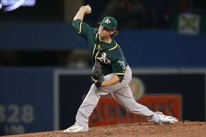 TORONTO, ON - MAY 19: Emilio Pagan #15 of the Oakland Athletics delivers a pitch in the sixth inning during MLB game action against the Toronto Blue Jays at Rogers Centre on May 19, 2018 in Toronto, Canada. (Photo by Tom Szczerbowski/Getty Images)