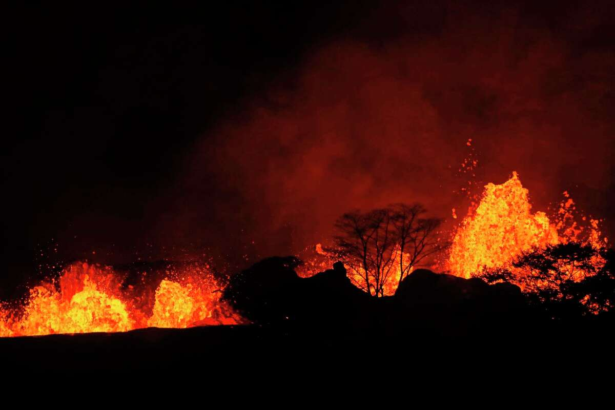 In this Saturday, May 19, 2018 photo, lava erupts inside the Leilani Estates in Pahoa, Hawaii. As lava flows have grown more vigorous in recent days, there's concern more homes may burn and more evacuations may be ordered. (Jamm Aquino/Honolulu Star-Advertiser via AP)