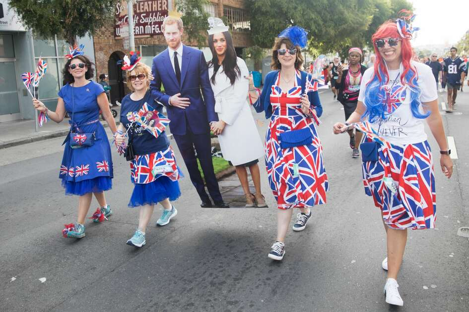 Prince Harry and Meghan Markle (cutouts) take part in the 2018 Bay to Breakers on May 20, 2018.