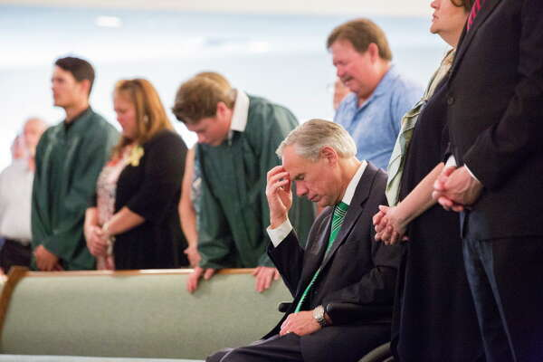 The Governor of Texas Greg Abbott joins a congregation in prayer at the Arcadia First Baptist Church two days after a shooting killed 10 people at Santa Fe High School, Sunday, May 20, 2018, in Santa Fe. Eight of the people killed were students.