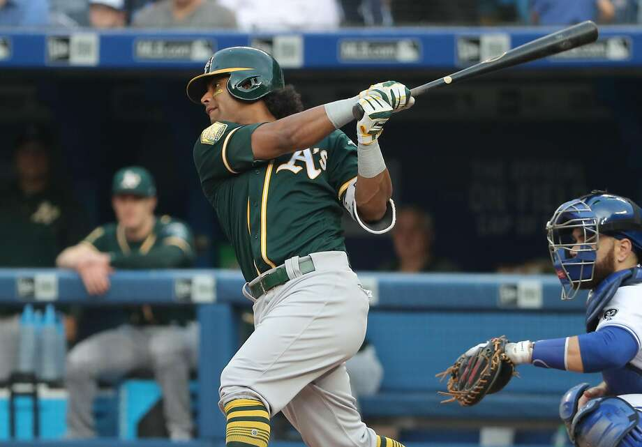 TORONTO, ON - MAY 17: Khris Davis #2 of the Oakland Athletics hits a single in the first inning during MLB game action against the Toronto Blue Jays at Rogers Centre on May 17, 2018 in Toronto, Canada. (Photo by Tom Szczerbowski/Getty Images) Photo: Tom Szczerbowski / Getty Images