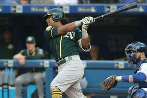 TORONTO, ON - MAY 17: Khris Davis #2 of the Oakland Athletics hits a single in the first inning during MLB game action against the Toronto Blue Jays at Rogers Centre on May 17, 2018 in Toronto, Canada. (Photo by Tom Szczerbowski/Getty Images)