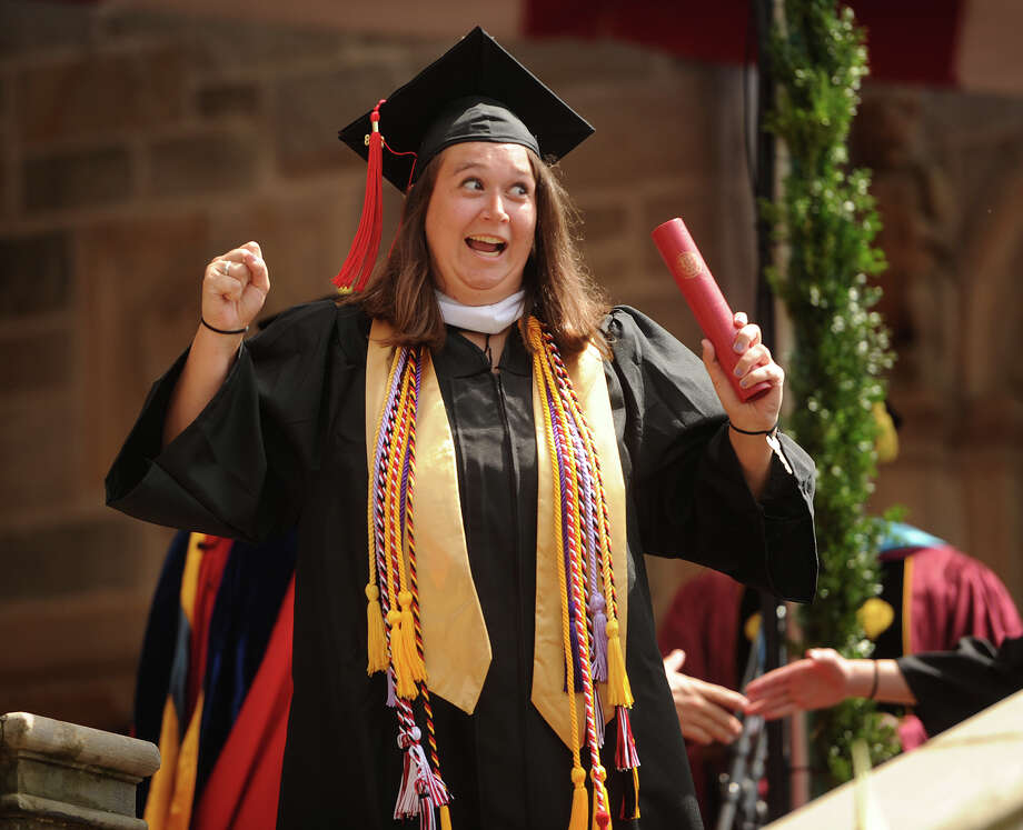 Graduate Rachel Zanfardino celebrates after receiving her diploma at the Fairfield University Commencement in Fairfield, Conn. on Sunday, May 20, 2018. Photo: Brian A. Pounds, Hearst Connecticut Media / Connecticut Post