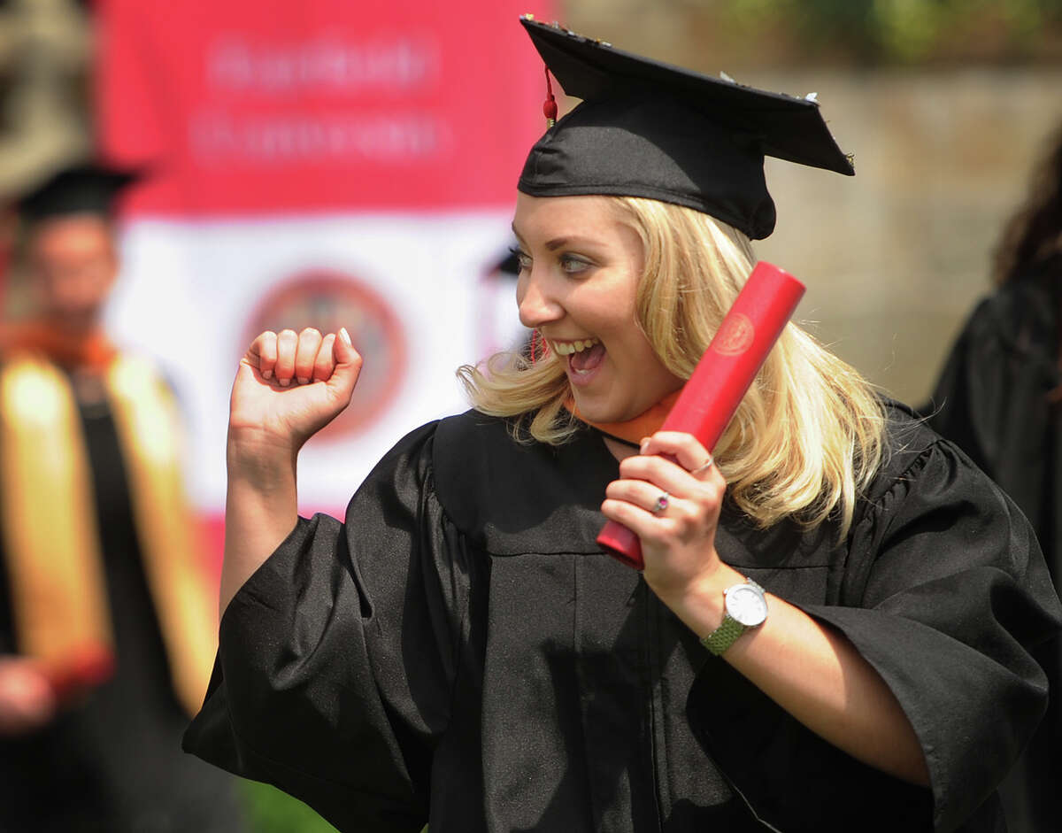 Graduate Alexa Fratarcangeli celebrates after receiving her diploma at the Fairfield University Commencement in Fairfield, Conn. on Sunday, May 20, 2018.