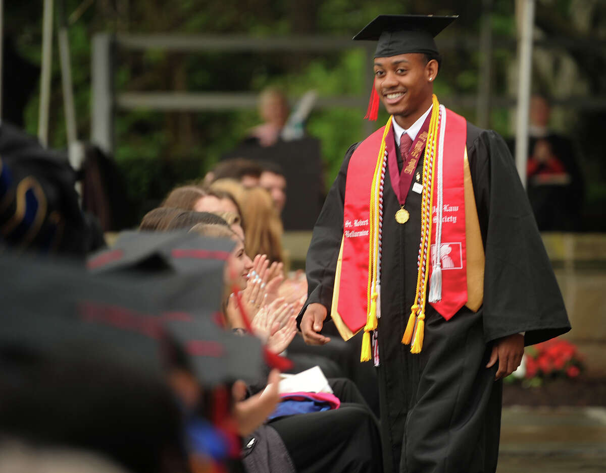 Valedictory Speaker Michael Harding returns to his seat after addressing his fellow graduates at the Fairfield University Commencement in Fairfield, Conn. on Sunday, May 20, 2018.