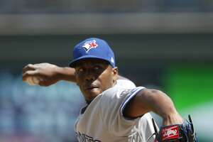 Toronto Blue Jays pitcher Carlos Ramirez throws against the Minnesota Twins in a baseball game Wednesday, May 2, 2018, in Minneapolis. (AP Photo/Jim Mone)
