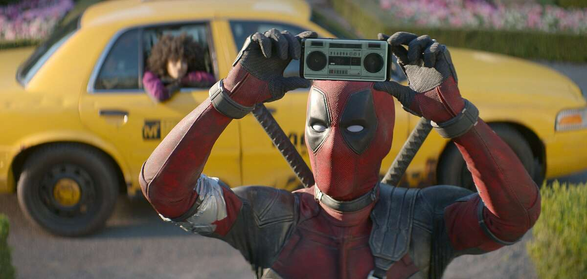 """FILE - This image released by Twentieth Century Fox shows Ryan Reynolds in a scene from """"Deadpool 2."""" Fox�s �Deadpool 2� brought in $125 million according to studio estimates Sunday, May 20, 2018, and ended the three-week reign of Disney�s �Avengers: Infinity War� at the top of the North American box office. (Twentieth Century Fox via AP, File)"""