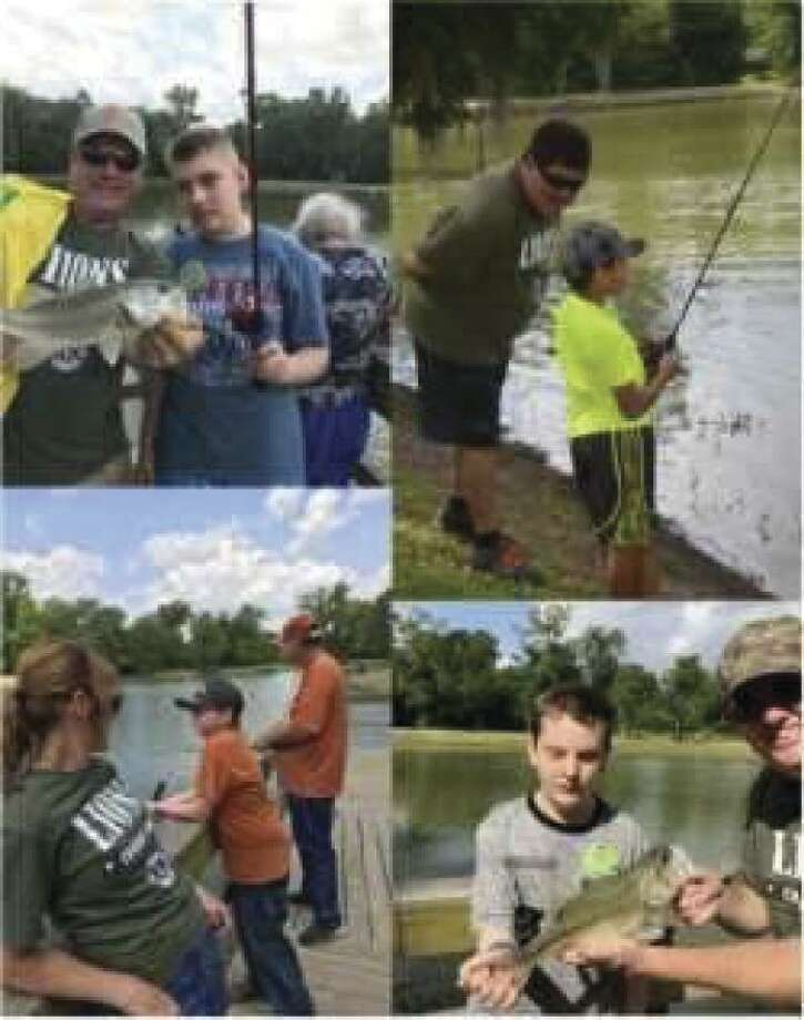 Conroe Noon Lions Club hosted their annual 'kids on the lake' - fishing tournament for special needs children last Saturday at Camp Owen next to the Conroe YMCA with 40 children, their parents and Lions to a day of fishing and FUN!