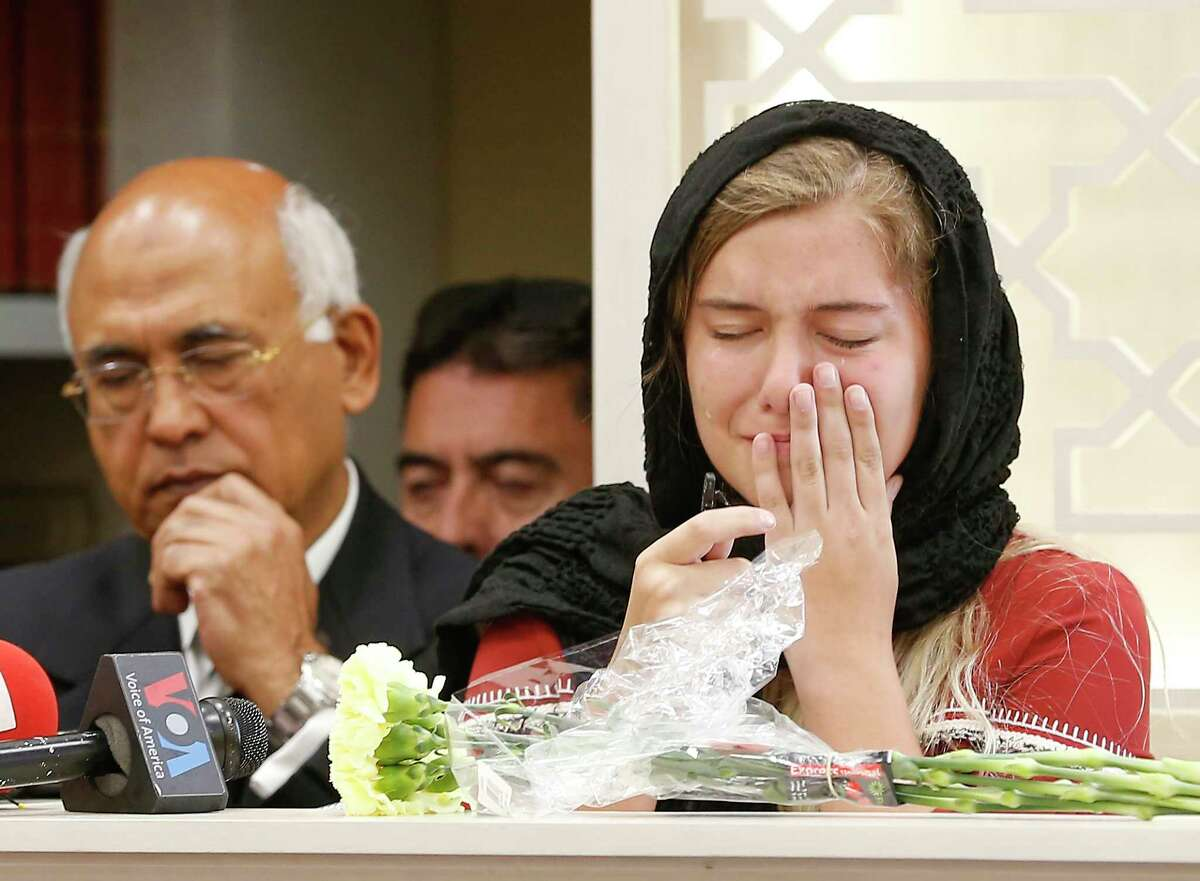 Host family daughter, Jaelyn Cogburn is over come with emotions when talking about her exchange student / friend, Sabika Sheikh, killed in Santa Fe High School shooting at Masjid Sabireen Sunday, May 20, 2018, in Stafford. M.J. Khan is in the background.