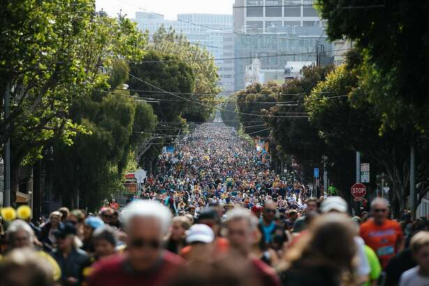 Participants make their way down Hayes Street in the Bay to Breakers annual race in San Francisco, Calif., Sunday, May 20, 2018.