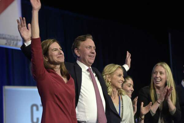 Ned Lamont stands with Susan Bysiewicz, left, and his wife Annie Lamont and family after receiving the nomination for Governor at the 2018 Connecticut Democratic State Convention, on Saturday, May 19, 2018, in Hartford, Conn.