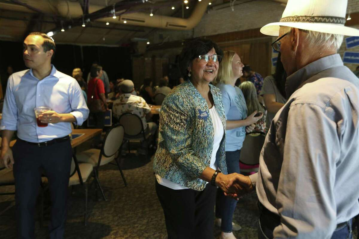 Democratic gubernatorial candidate Lupe Valdez (center) greets Jose Carrasquillo as she and former Housing Secretary Julian Castro (left) stump for her campaign at Blue Star Brewing on Saturday, May 19, 2018. The Democrats' debate over how best to capitalize on the anger and angst stirred by Trump is exemplified -- albeit imperfectly -- by the candidates competing for the party nod for governor, former Dallas County sheriff Lupe Valdez and Houston businessman Andrew White. On Saturday, Valdez and Castro spoke in San Antonio to a roomful of voters about their choices between a moderate who can appeal to Republicans and a progressive candidate who was expected to excite the base. (Kin Man Hui/San Antonio Express-News)