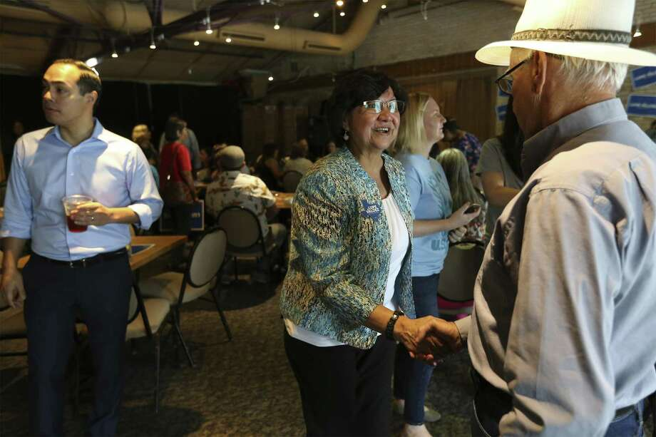 Democratic gubernatorial candidate Lupe Valdez (center) greets Jose Carrasquillo as she and former Housing Secretary Julian Castro (left) stump for her campaign at Blue Star Brewing on Saturday, May 19, 2018. The Democrats' debate over how best to capitalize on the anger and angst stirred by Trump is exemplified -- albeit imperfectly -- by the candidates competing for the party nod for governor, former Dallas County sheriff Lupe Valdez and Houston businessman Andrew White. On Saturday, Valdez and Castro spoke in San Antonio to a roomful of voters about their choices between a moderate who can appeal to Republicans and a progressive candidate who was expected to excite the base. (Kin Man Hui/San Antonio Express-News) Photo: Kin Man Hui, Staff / San Antonio Express-News / ©2018 San Antonio Express-News