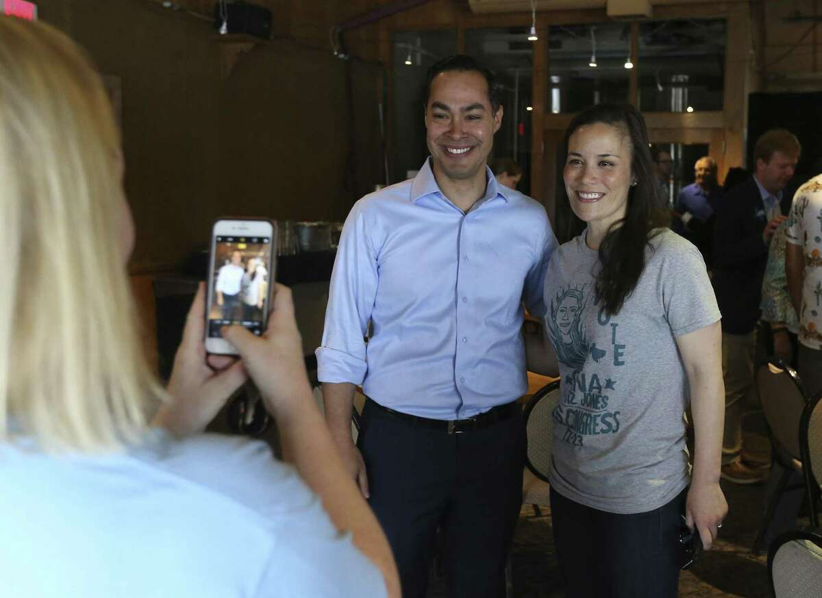 Former Housing Secretary Julian Castro poses for a photo with Democratic congressional candidate Gina Ortiz Jones at a campaign gathering for Democratic gubernatorial candidate Lupe Valdez at Blue Star Brewing on Saturday, May 19, 2018. The Democrats' debate over how best to capitalize on the anger and angst stirred by Trump is exemplified -- albeit imperfectly -- by the candidates competing for the party nod for governor, former Dallas County sheriff Lupe Valdez and Houston businessman Andrew White. On Saturday, Valdez and Castro spoke in San Antonio to a roomful of voters about their choices between a moderate who can appeal to Republicans and a progressive candidate who was expected to excite the base. (Kin Man Hui/San Antonio Express-News)