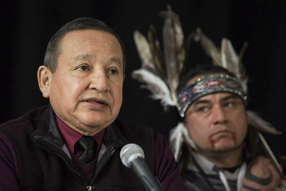 The Grand Chief of the Union of British Columbia Indian Chiefs, Stewart Phillip, gives a news conference on April 16, 2018 with indigenous leaders and politicians opposed to the expansion of the Trans Mountain oil pipeline in Vancouver, Canada. Behind is William George, a member of the Tsleil-Waututh First Nation and a guardian at the watch house near Kinder Morgan Inc. Burnaby oil facility. Photo: Darryl Dyck, SUB / Associated Press / Canadian Press