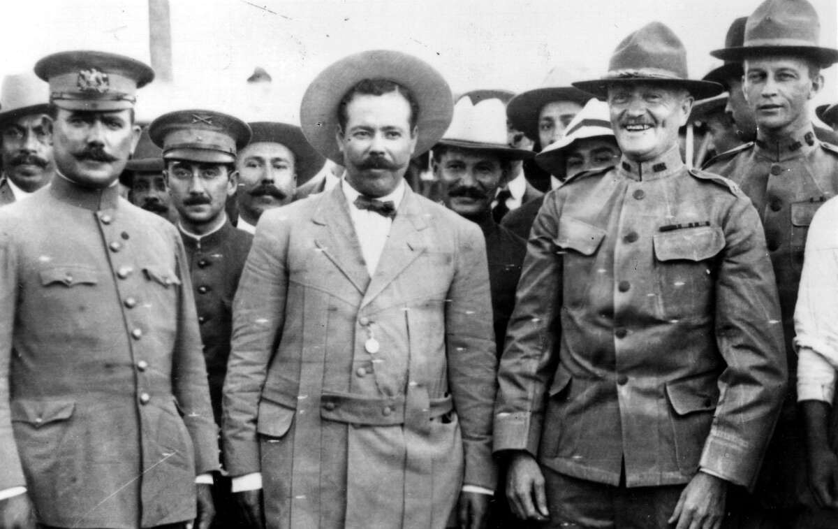 """This picture, taken at the border at Nogales, Ariz., prior to March of 1916, shows left to right, Gen. Alvaro Obregon, (front left) Gen. Pancho Villa (front, center) and Gen. John J. Pershing in a friendly meeting. At far right is Pershing's special aide, Lt. George Patton. A few months afterward the three generals becames """"enemies on the field"""" as Pershing dashed into Mexico in pursuit of Villa. EXPRESS-NEWS FILE PHOTO / COURTESY EL PASO PUBLIC LIBRARY"""